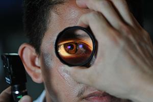 doctor performing eye exam